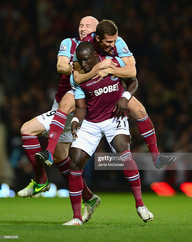 Mohamed Diame of West Ham United celebrates scoring his team's second goal with team mates James Collins (L) and Gary O'Neil during the Barclays Premier League match between West Ham United and Manchester United at the Boleyn Ground on April 17, 2013 in London, England.