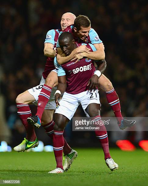 Mohamed Diame of West Ham United celebrates scoring his team's second goal with team mates James Collins and Gary O'Neil during the Barclays Premier...