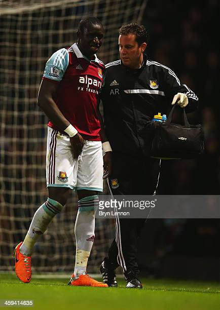 Mohamed Diame of West Ham United is given assistance during the Barclays Premier League match between West Ham United and Arsenal at Boleyn Ground on...