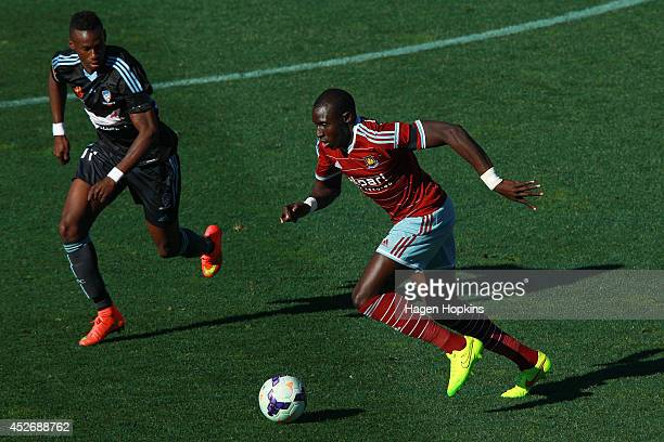 Mohamed Diame of West Ham United runs the ball under pressure from Bernie IbiniIsei of Sydney FC during the Football United New Zealand Tour 2014...