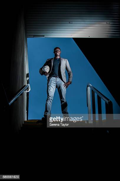 Mohamed Diame poses for a photograph at the top of some steps whilst holding a football at StJames' Park on August 2 in Newcastle upon Tyne England