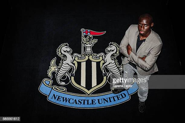 Mohamed Diame poses for a photograph with the club crest at StJames' Park on August 2 in Newcastle upon Tyne England