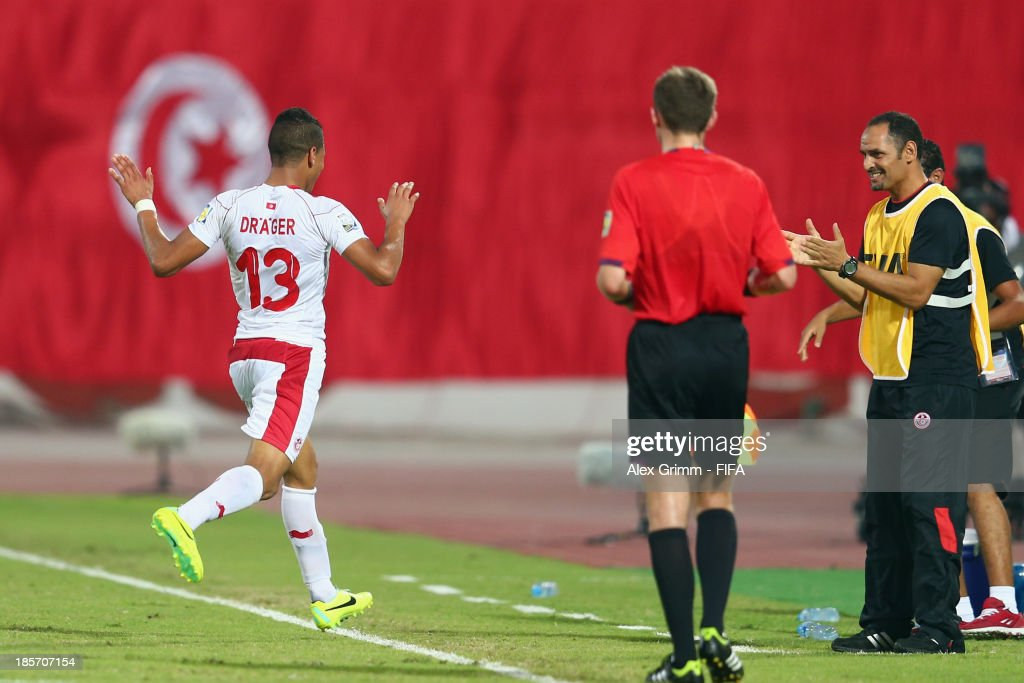 Mohamed Drager of Tunisia celebrates his team's first goal during the FIFA U-17 World Cup UAE 2013 Group D match between Japan and Tunisia at Sharjah Stadium on October 24, 2013 in Sharjah, United Arab Emirates.