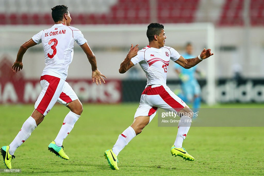 Mohamed Drager (R) of Tunisia celebrates his team's first goal with team mate Amuer El Omrani during the FIFA U-17 World Cup UAE 2013 Group D match between Japan and Tunisia at Sharjah Stadium on October 24, 2013 in Sharjah, United Arab Emirates.