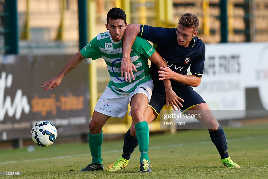 Mohamed El Idrissi of KSK Hasselt is tackled by Calum Chambers of Southampton during the pre-season friendly match between KSK Hasselt and Southampton at the Stedelijk Sportstadion on July 17, 2014 in Hasselt, Belgium.