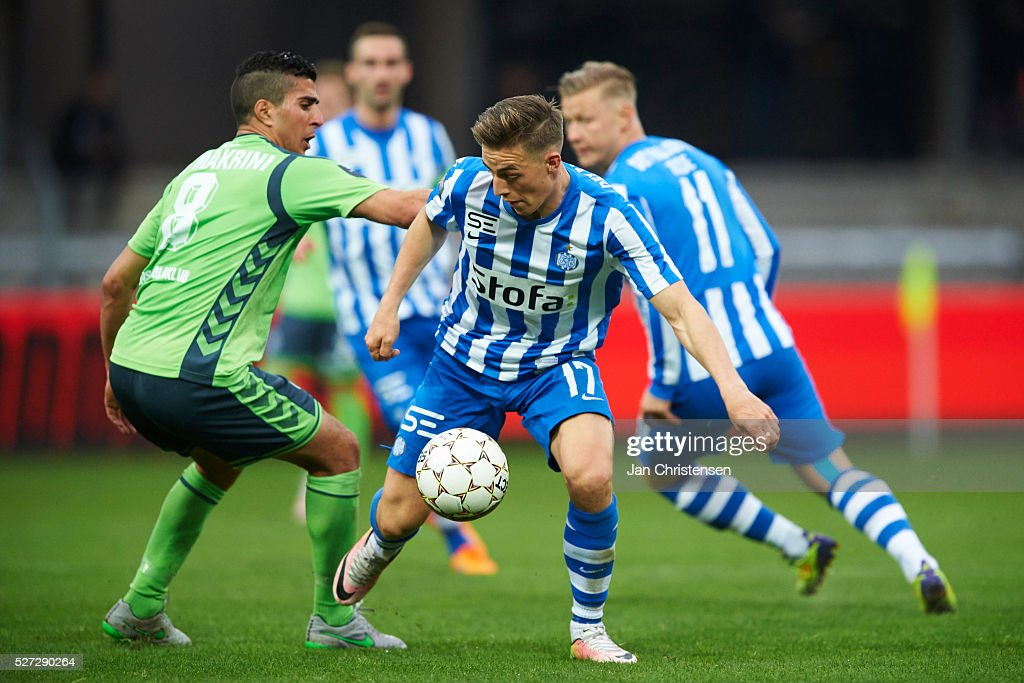Mohamed El Makrini of OB Odense and Casper Nielsen of Esbjerg fB compete for the ball during the Danish Alka Superliga match between Esbjerg fB and OB Odense at Blue Water Arena on May 02, 2016 in Esbjerg, Denmark.