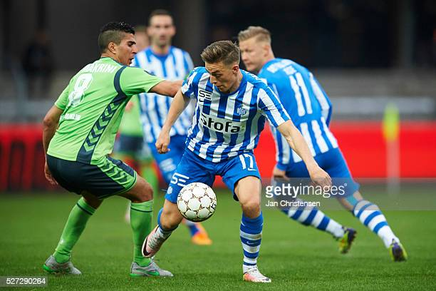 Mohamed El Makrini of OB Odense and Casper Nielsen of Esbjerg fB compete for the ball during the Danish Alka Superliga match between Esbjerg fB and...