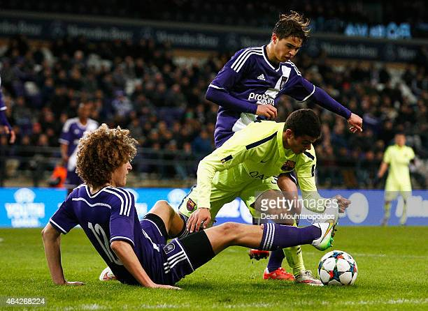 Mohamed El Ouriachi of Barcelona battles for the ball with Samy Bourard and Wout Faes of Anderlecht during the UEFA Youth League Round of 16 match...