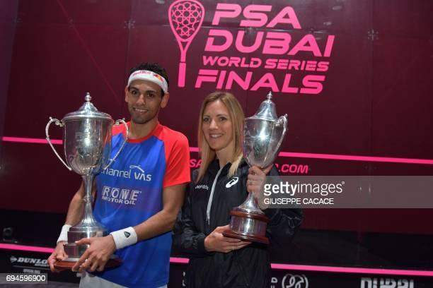 Mohamed El Shorbagy of Egypt and Laura Massaro of England pose with the trophies after winning the finals of the PSA Dubai World Series Finals 2017...
