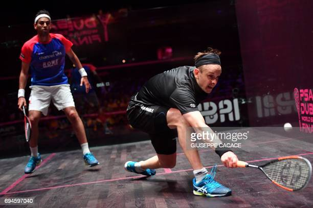Mohamed El Shorbagy of Egypt competes against James Willstrop of England during the finals of the PSA Dubai World Series Finals 2017 at Dubai Opera...