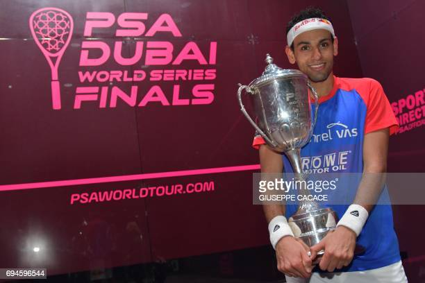 Mohamed El Shorbagy of Egypt holds the trophy after winning the finals of the PSA Dubai World Series Finals 2017 at Dubai Opera on June 10 2017 in...