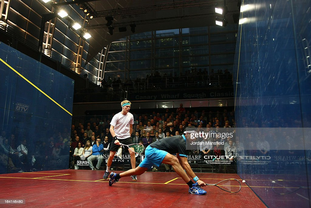 Mohamed El Shorbagy of Egypt in action against Henrik Mustonen (L) of Finland during their quarter-final match in the Canary Wharf Squash Classic on March 20, 2013 in London, England.