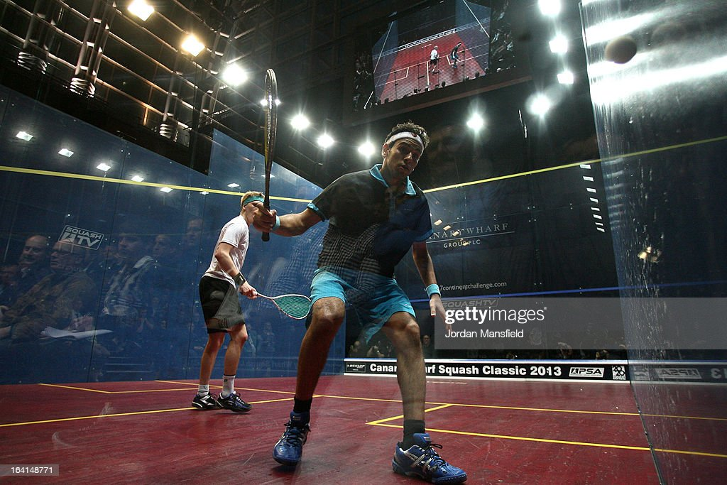 Mohamed El Shorbagy of Egypt in action against Henrik Mustonen of Finland during their quarter-final match in the Canary Wharf Squash Classic on March 20, 2013 in London, England.