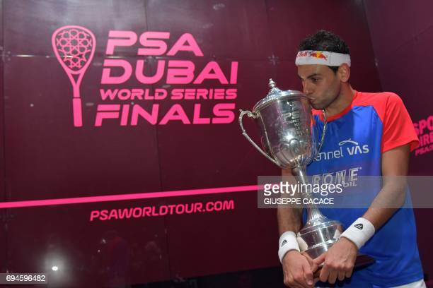 Mohamed El Shorbagy of Egypt kisses the trophy after winning the finals of the PSA Dubai World Series Finals 2017 at Dubai Opera on June 10 2017 in...