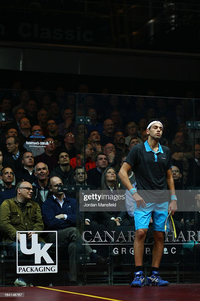 Mohamed El Shorbagy of Egypt looks despondent during his quarter-final match against Henrik Mustonen of Finland in the Canary Wharf Squash Classic on March 20, 2013 in London, England.