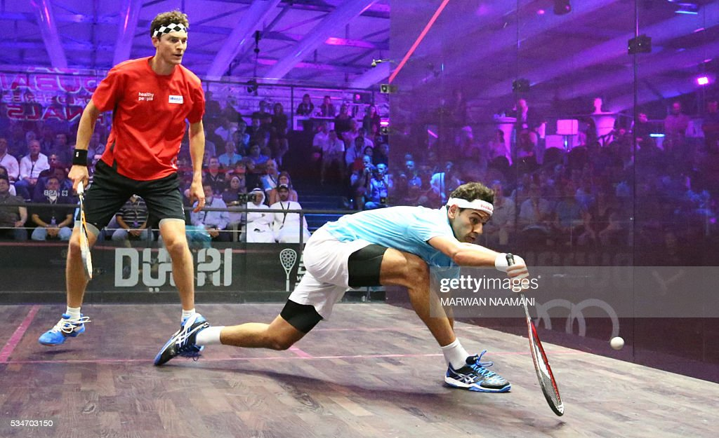 Mohamed El Shorbagy (R) of Egypt plays a forehand to Cameron Pilley of Australia during their semi-final match of the Dubai PSA World Series Finals squash tournament in Dubai on May 27, 2016. / AFP / MARWAN