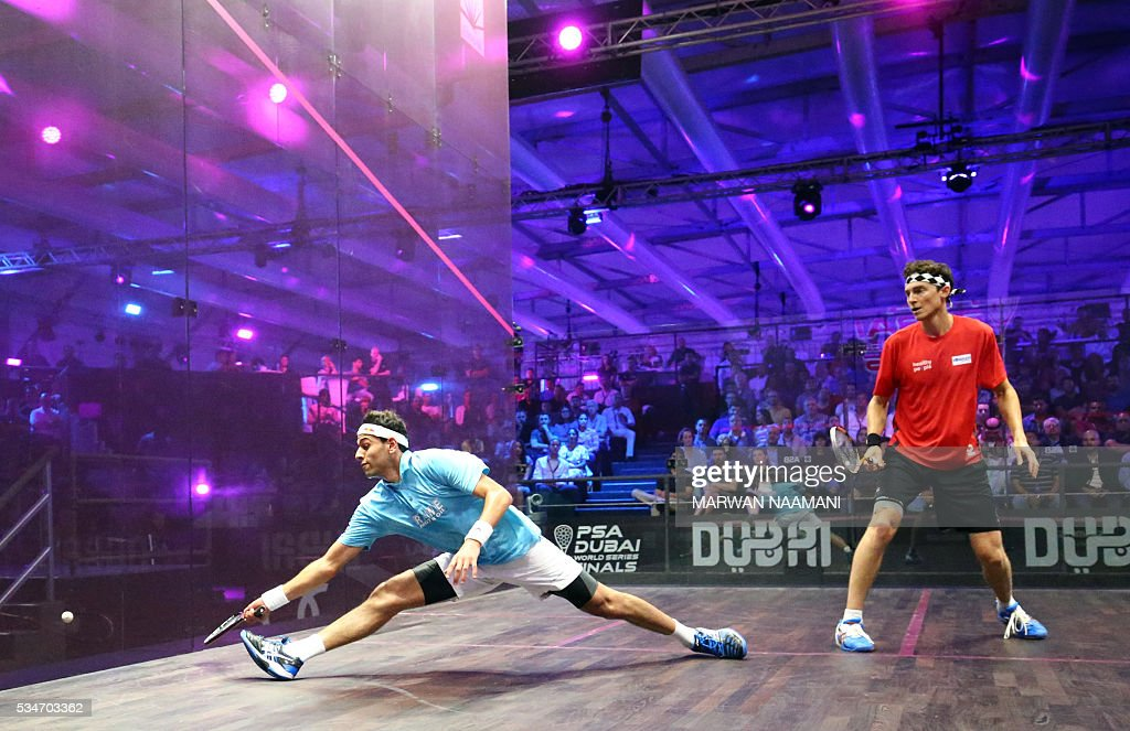 Mohamed El Shorbagy of Egypt (L) plays a forehand to Cameron Pilley of Australia during their semi-final match of the Dubai PSA World Series Finals squash tournament in Dubai on May 27, 2016. / AFP / MARWAN
