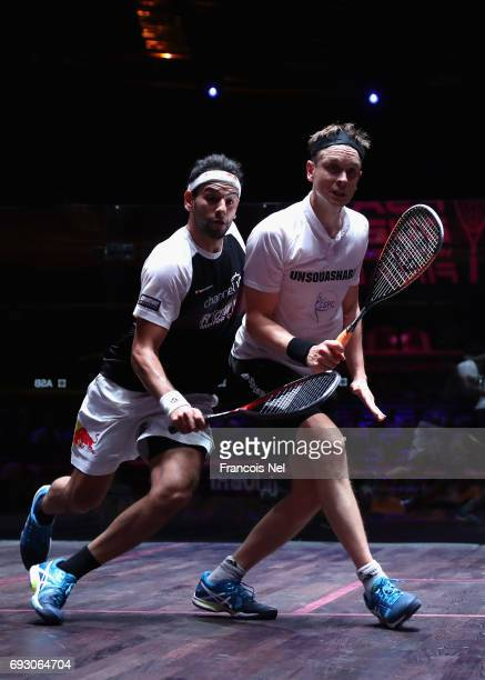 Mohamed El Shorbagy of Egypty competes against James Willstrop of England during day one of the PSA Dubai World Series Finals 2017 at Dubai Opera on...