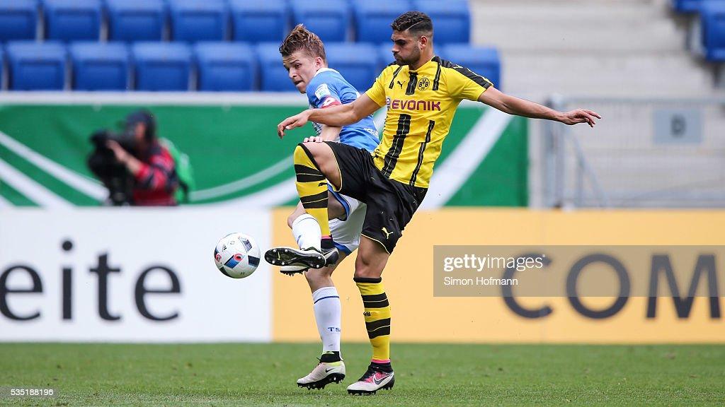 Mohamed El-Bouzzati of Dortmund is challenged by David Otto of Hoffenheim during the A Juniors German Championship Final match between 1899 Hoffenheim U19 and Borussia Dortmund U19 at Wirsol Rhein-Neckar-Arena on May 29, 2016 in Sinsheim, Germany.
