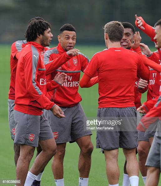 Mohamed Eleney Francis Coquelin and Alex Iwobi of Arsenal joke around before a training session at London Colney on October 21 2016 in St Albans...