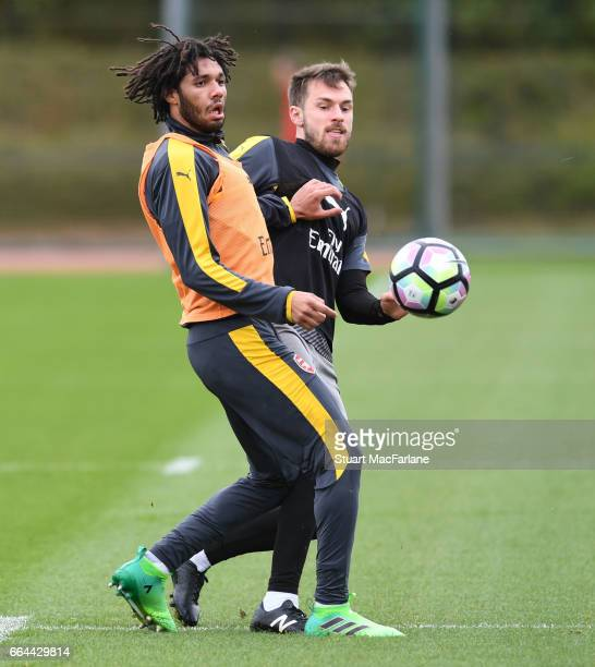 Mohamed Elneny and Aaron Ramsey of Arsenal during a training session at London Colney on April 4 2017 in St Albans England