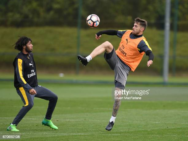 Mohamed Elneny and Aaron Ramsey of Arsenal during a training session at London Colney on April 20 2017 in St Albans England