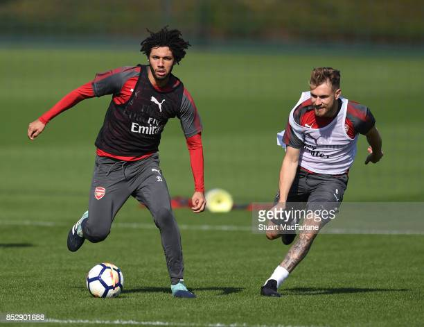 Mohamed Elneny and Aaron Ramsey of Arsenal during a training session at London Colney on September 24 2017 in St Albans England