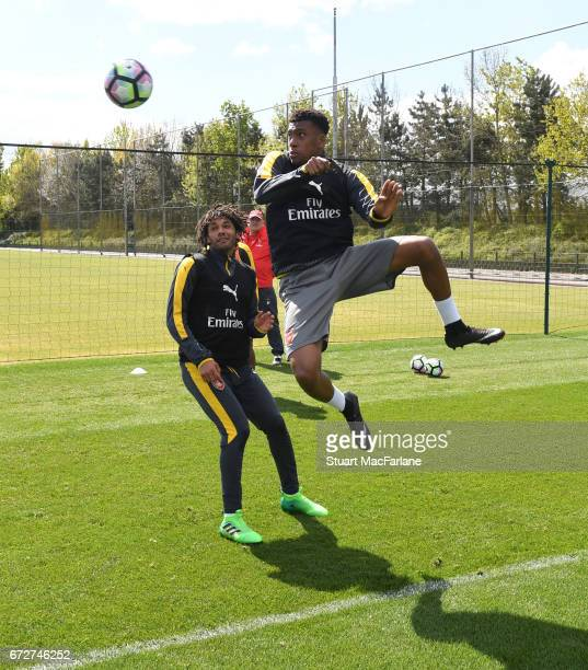 Mohamed Elneny and Alex Iwobi of Arsenal during a training session at London Colney on April 25 2017 in St Albans England