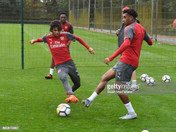 Mohamed Elneny and Alex Iwobi of Arsenal during a training session at London Colney on October 13 2017 in St Albans England