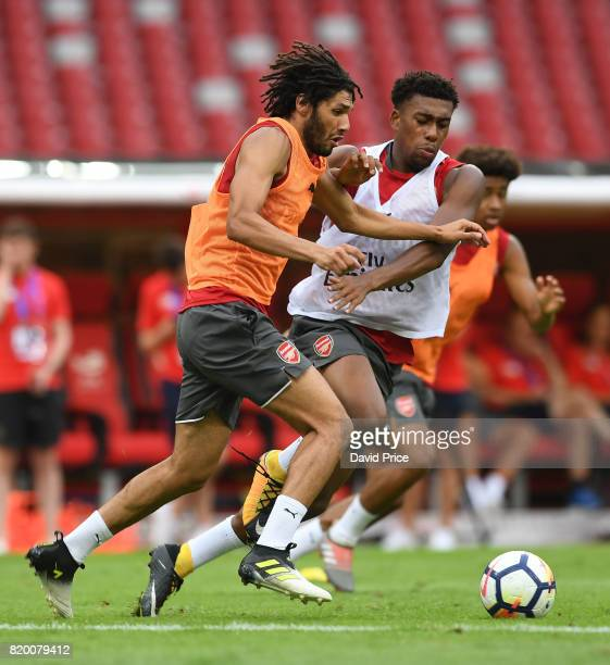 Mohamed Elneny and Alex Iwobi of Arsenal during an Arsenal Training Session at the Birds Nest on July 21 2017 in Beijing China