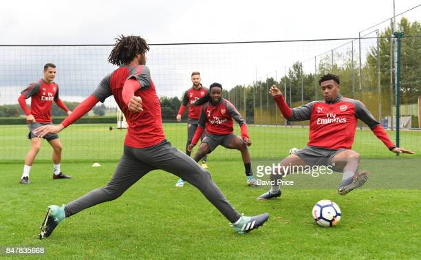 Mohamed Elneny and Alex Iwobi of Arsenal during Arsenal 1st team training session at London Colney on September 16 2017 in St Albans England