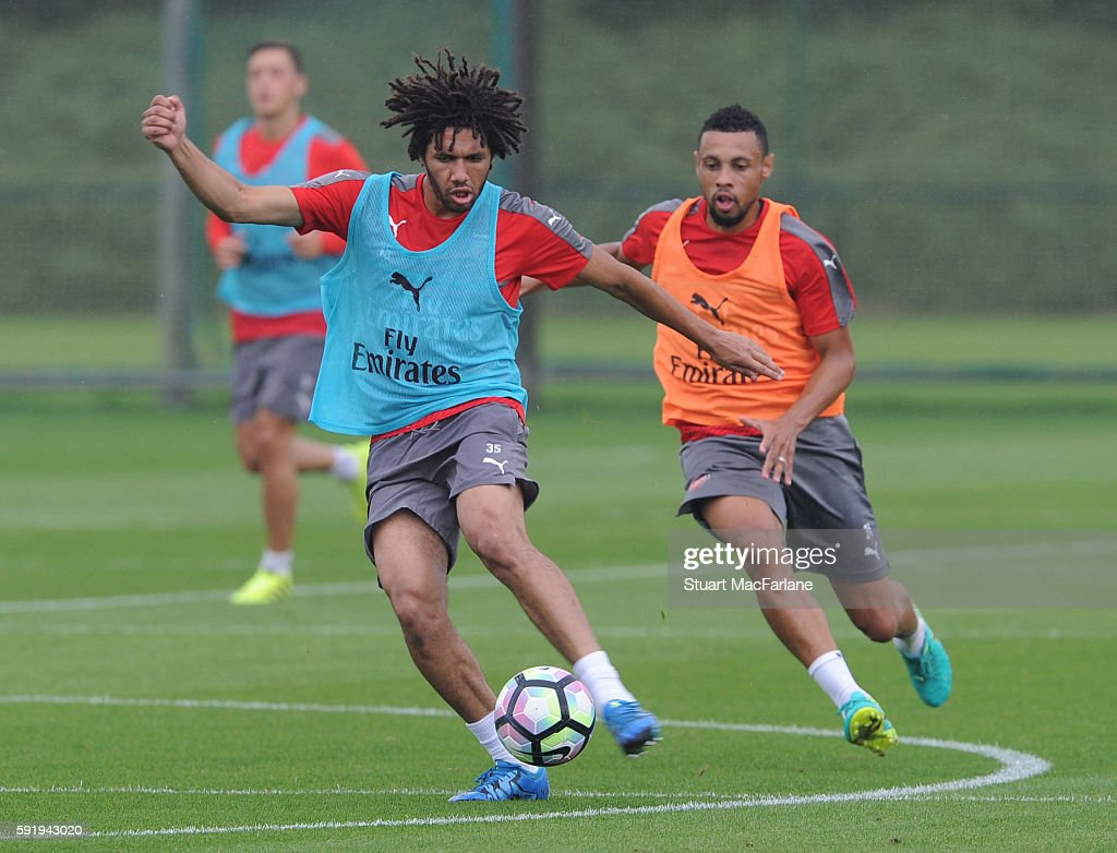 Mohamed Elneny and Francis Coquelin of Arsenal during a training session at London Colney on August 19 2016 in St Albans England