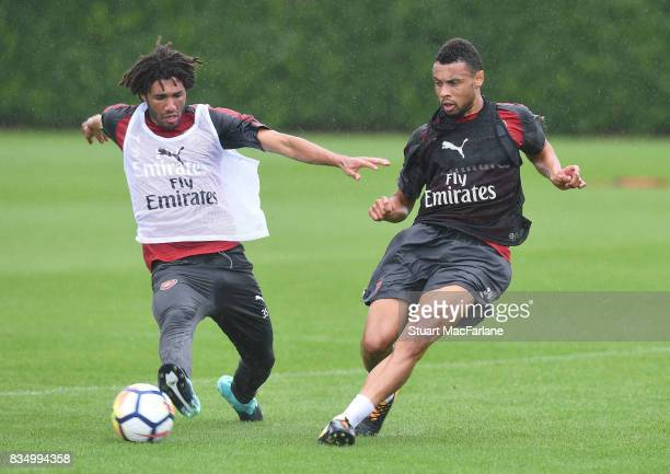 Mohamed Elneny and Francis Coquelin of Arsenal during a training session at London Colney on August 18 2017 in St Albans England