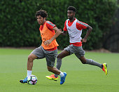 Mohamed Elneny and Gedion Zelalem of Arsenal during a training session at London Colney on July 21 2016 in St Albans England