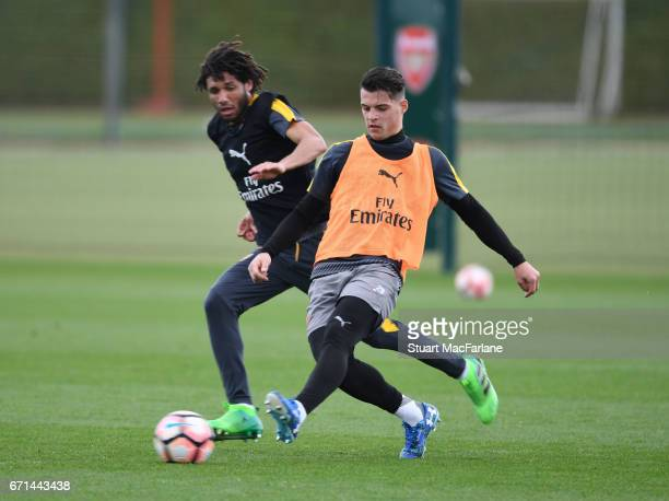 Mohamed Elneny and Granit Xhaka of Arsenal during a training session at London Colney on April 22 2017 in St Albans England