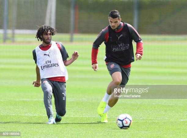 Mohamed Elneny and Granit Xhaka of Arsenal during a training session at London Colney on August 10 2017 in St Albans England