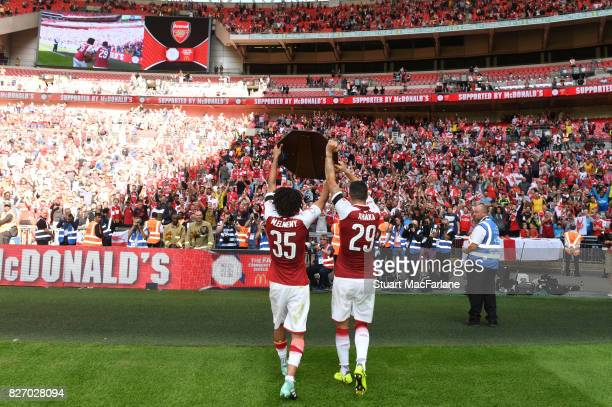Mohamed Elneny and Granit Xhaka of Arsenal with the Community shield after the FA Community Shield match between Chelsea and Arsenal at Wembley...