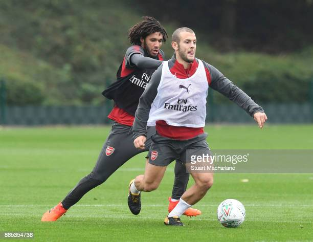 Mohamed Elneny and Jack Wilshere of Arsenal during a training session at London Colney on October 23 2017 in St Albans England
