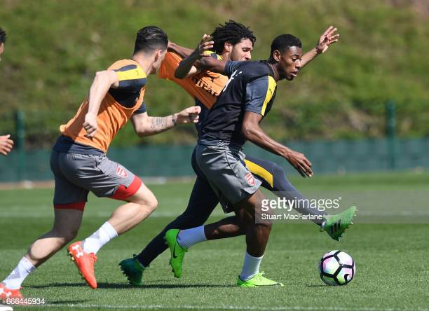 LR0 Mohamed Elneny and Jeff ReineAdelaide of Arsenal during a training session at London Colney on April 9 2017 in St Albans England