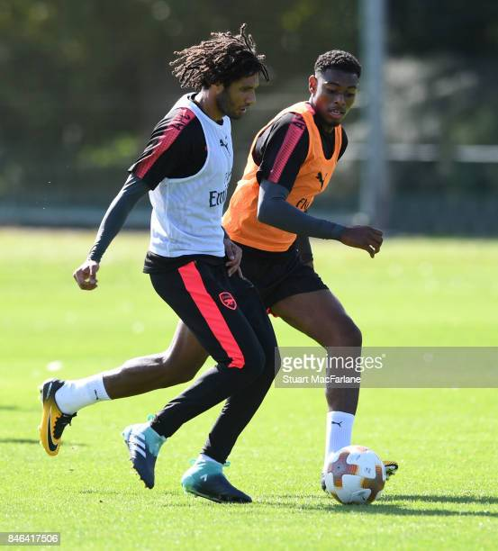 Mohamed Elneny and Jeff ReineAdelaide of Arsenal during a training session at London Colney on September 13 2017 in St Albans England