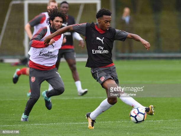 Mohamed Elneny and Joe Willock of Arsenal during a training session at London Colney on August 2 2017 in St Albans England