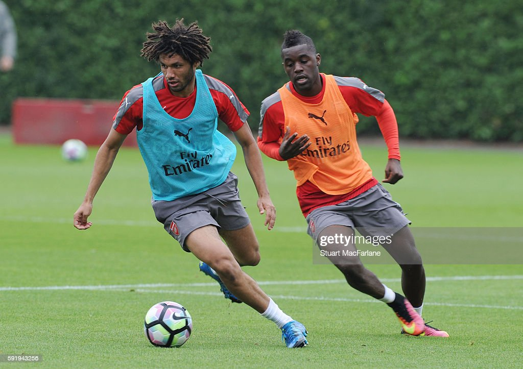 Mohamed Elneny and Joel Campbell of Arsenal during a training session at London Colney on August 19 2016 in St Albans England