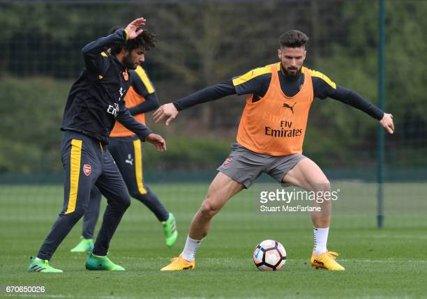 Mohamed Elneny and Olivier Giroud of Arsenal during a training session at London Colney on April 20 2017 in St Albans England