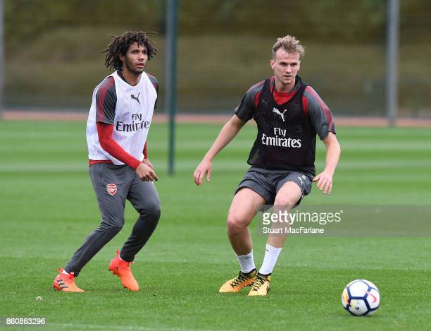 Mohamed Elneny and Rob Holding of Arsenal during a training session at London Colney on October 13 2017 in St Albans England
