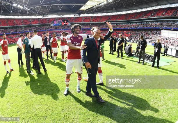 Mohamed Elneny and Santi Cazorla after the FA Community Shield match between Chelsea and Arsenal at Wembley Stadium on August 6 2017 in London England