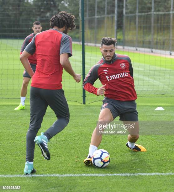 Mohamed Elneny and Sead Kolasinac of Arsenal during a training session at London Colney on August 10 2017 in St Albans England