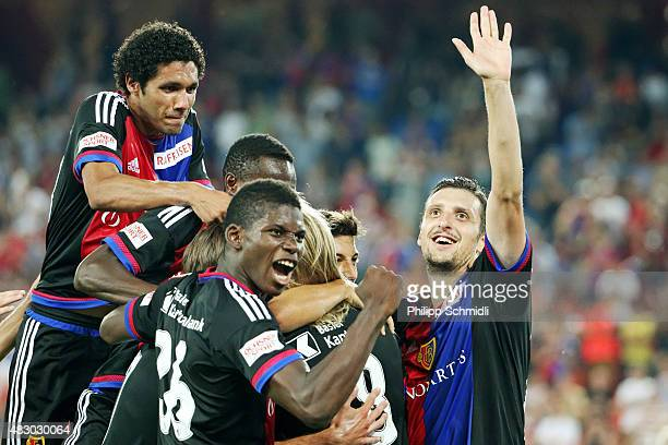 Mohamed Elneny Breel Embolo and Zdravko Kuzmanovic of FC Basel celebrate with their teammates during the UEFA Champions League third qualifying round...
