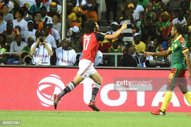 Mohamed Elneny celebrates scoring during the African Nations Cup Final match between Cameroon and Egypt at Stade de L'Amitie on February 5 2017 in...