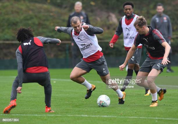 Mohamed Elneny Jack Wilshere and Rob Holding of Arsenal during a training session at London Colney on October 23 2017 in St Albans England