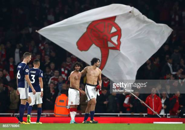 Mohamed Elneny of Arsenal and Ahmed ElSayed Hegazi of West Bromwich Albion swap shirts after the Premier League match between Arsenal and West...